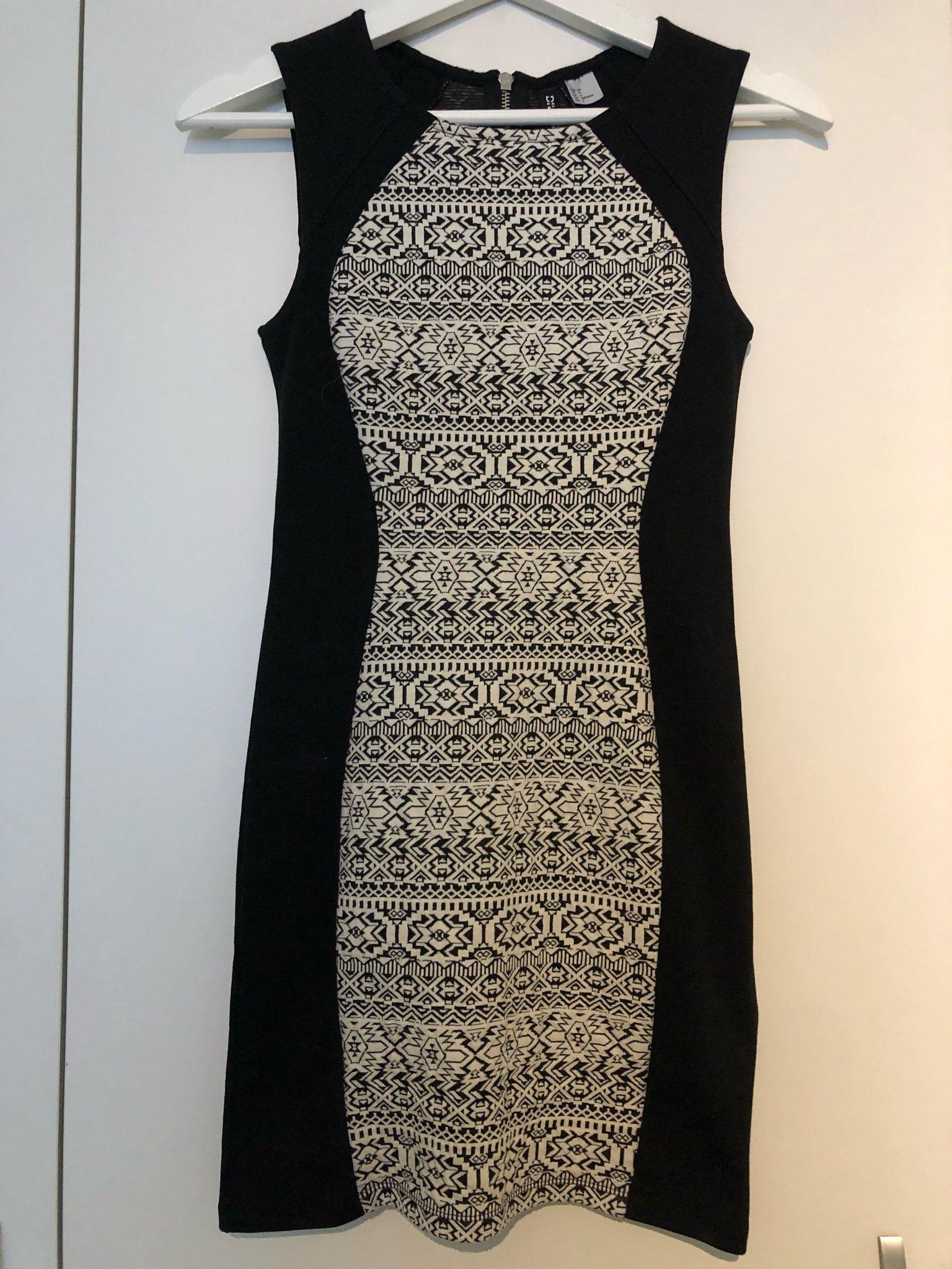 c9518d42a1f4 Svart vit klänning från HM Divided storlek 34 (349420076) ᐈ Köp på ...