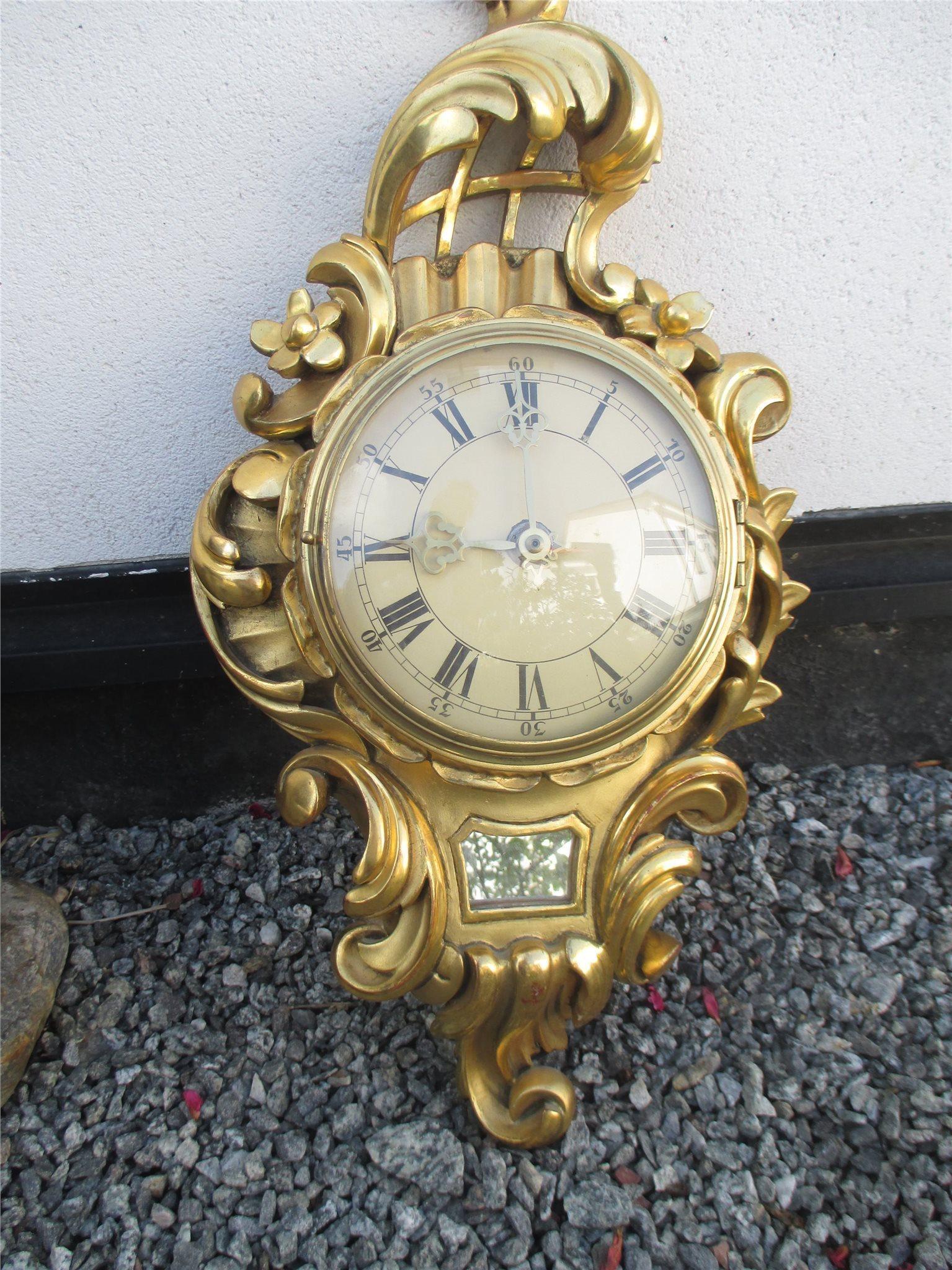 spegel med klocka