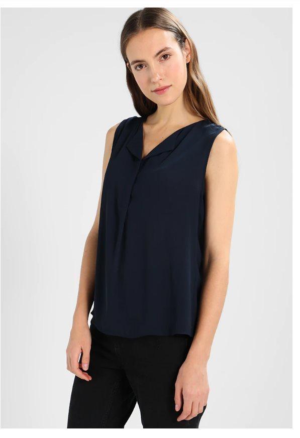 Nytt marinblått linne strl L från VILA