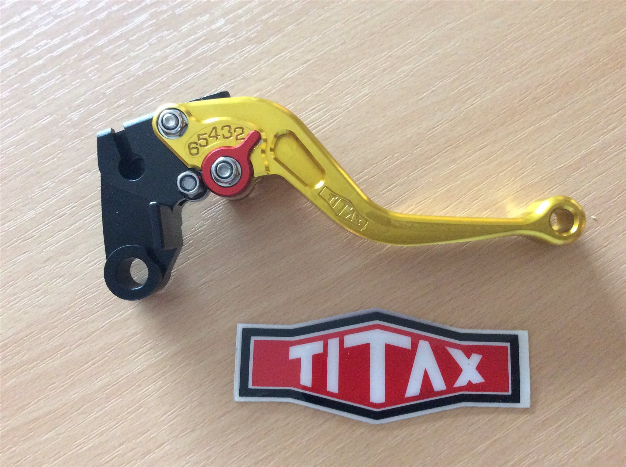 TITAX, Racing product. Clutch Lever Shotr Gold till Kawasaki.