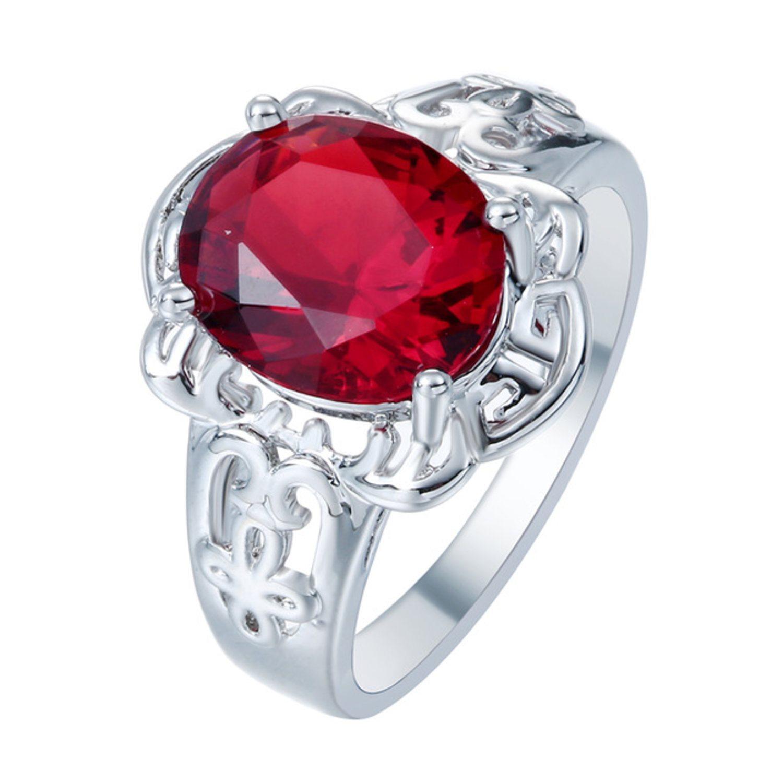 silverring med röd sten