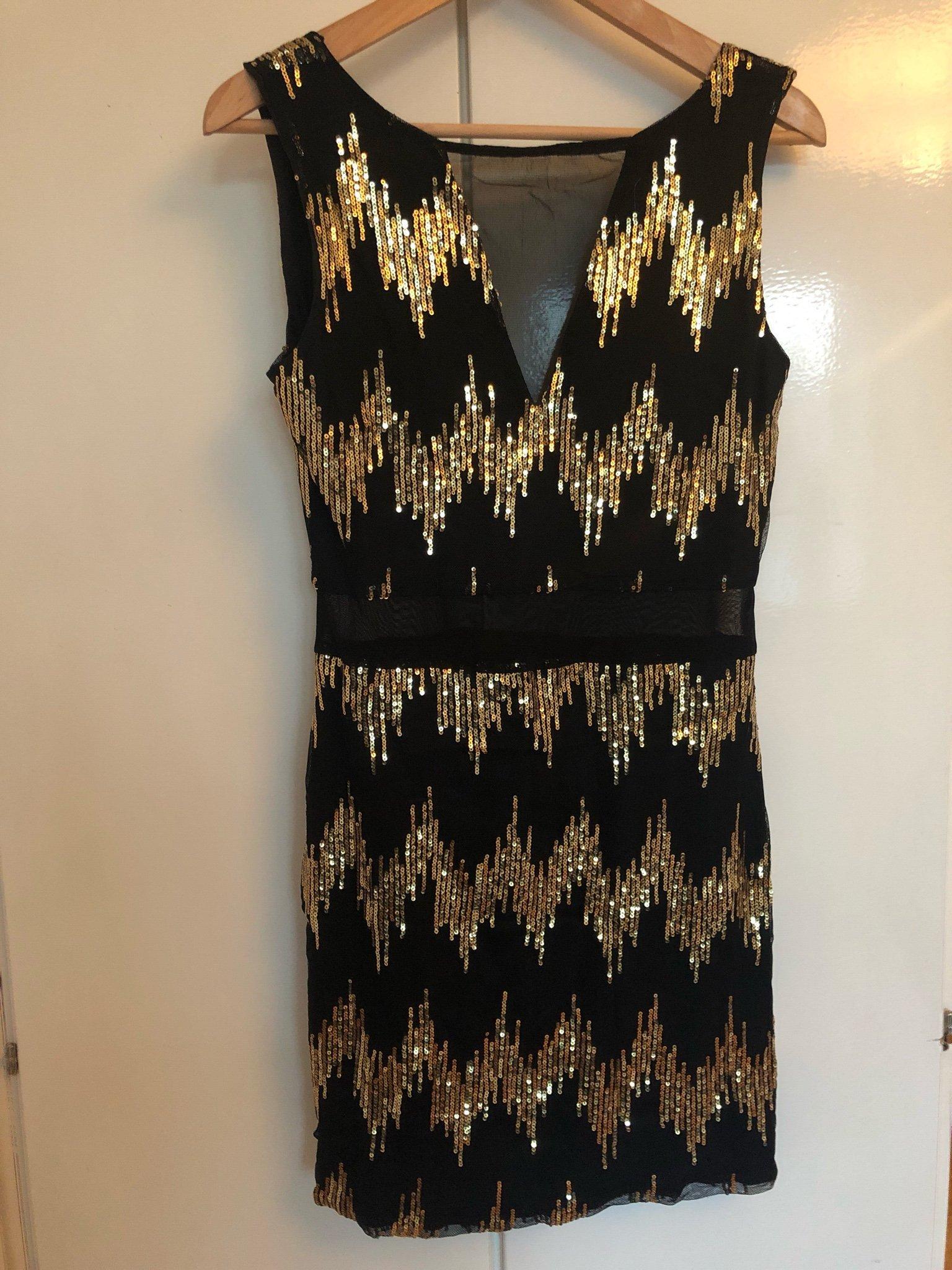 5bb545cedec6 Paljettklänning i svart och guld (347182370) ᐈ Köp på Tradera