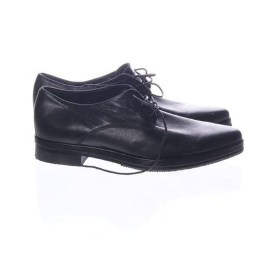 Svarta casual skor i konstläder