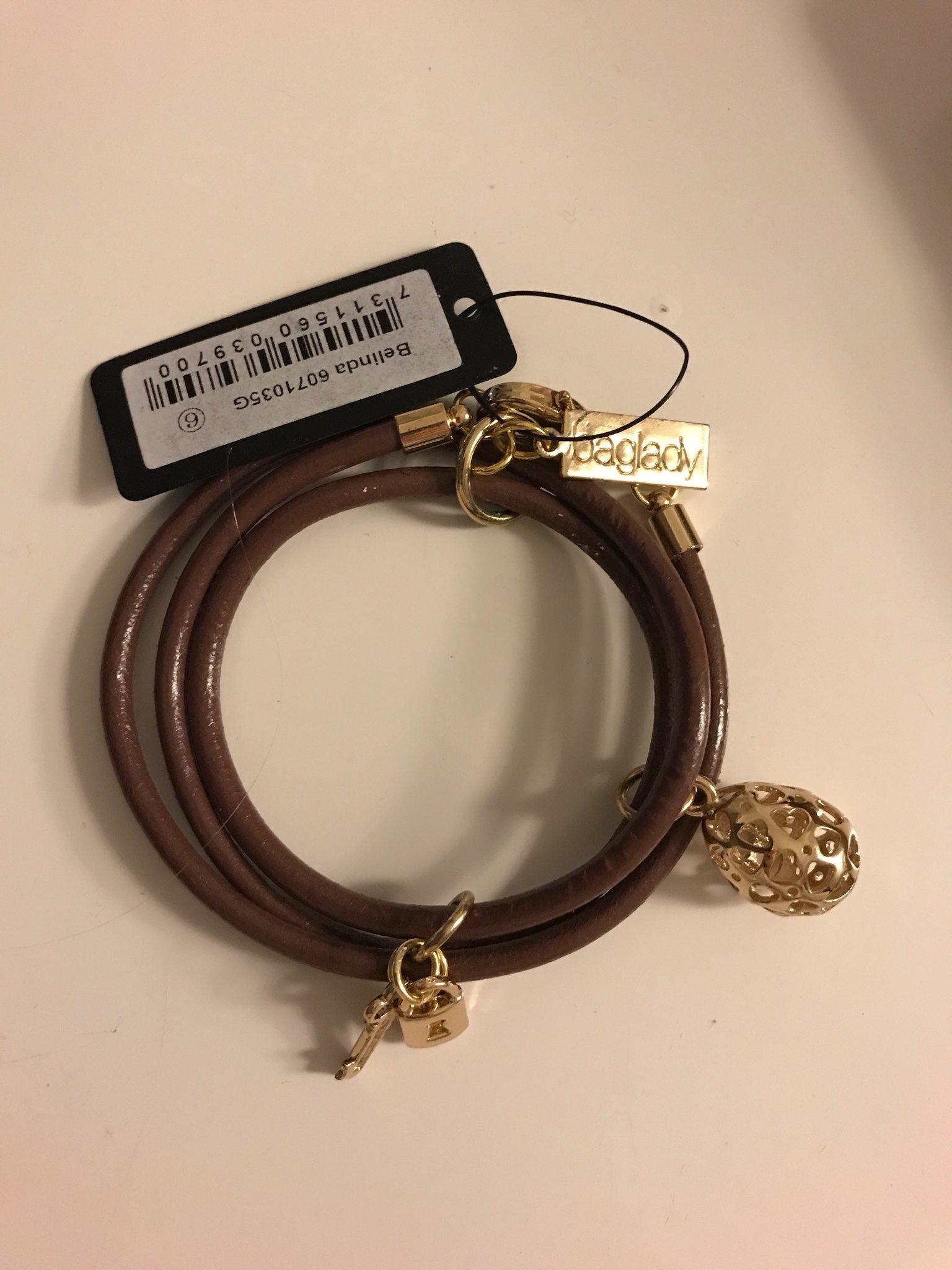 brun baglady armband med hängsmycken på tradera - Övriga armband |
