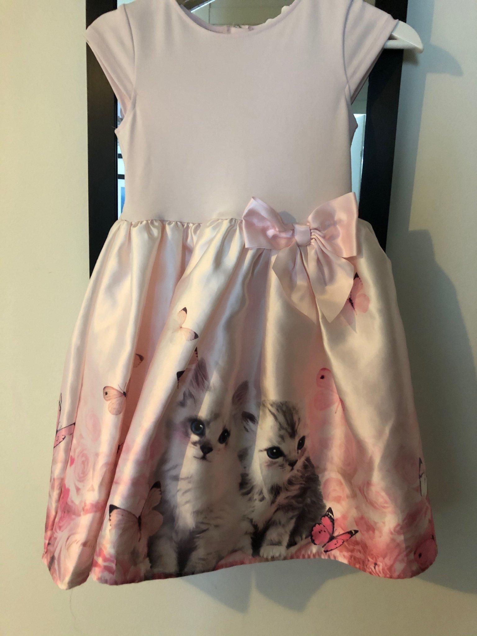 Barn klänning stl 134