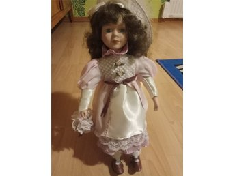 A Porcelain Doll 50 cm with stand