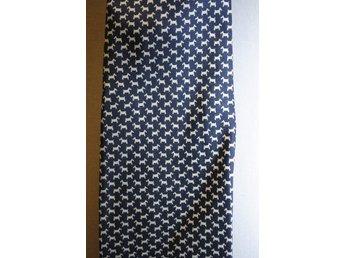 Javascript är inaktiverat. - Vällingby - VINTAGE SIDENSLIPS HUNDAR I MÖNSTERArtnummer 13005Sidenslips vintage.Små hundar i mönster.i gott skick.Design Nicola Ferri ItalienBredd 10 cm - Vällingby