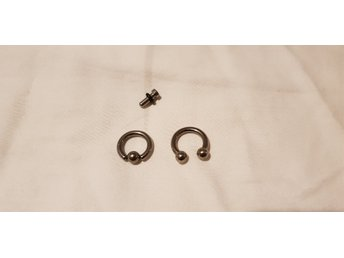 Cirkular barbell och ball closure ring samt retainer