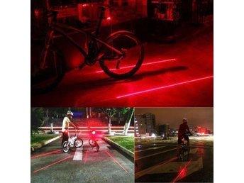 Cykellampa med 2 röda laser streck - örebro - Cykellampa med 2 röda laser streck - örebro