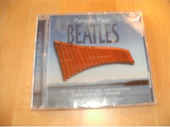 NY INPLASTAD CD- Panpipe plays The Beatles