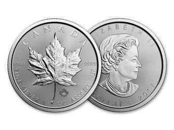 Javascript är inaktiverat. - Piteå - Kanadensisk Silver Maple 2017 - 1 oz silvermynt. Präglade av välkända Royal Canadian Mint. Silver Maples är det mest välkända investeringsmyntet efter Silver Eagles. Designen illustrerar det kanadensiska lönnlövet på baksidan och drottni - Piteå