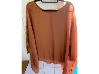 Top i viskos  one size  rost/orange 100:-