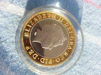 2 pounds england silver med guld