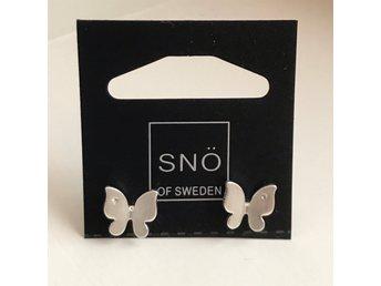 snö örhängen fjärilar