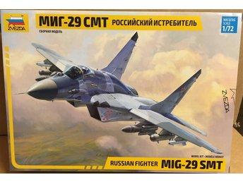 Javascript är inaktiverat. - Mantorp - MIG-29 SMT RUSSIAN FIGHTER 1/72 Zvezda byggsats Modellen krävs verktyg, lim och eventuellt färg Ingen avhämtning - Mantorp