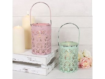 Gorgeous light pink rustic candle holder.