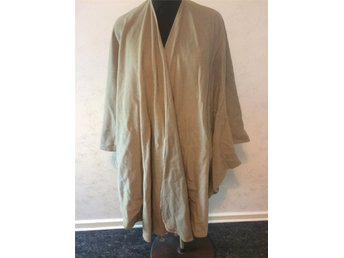 Poncho Anette Beinard med in Sweden ,70 % ull ,20 % polyester ,10 %cashmere