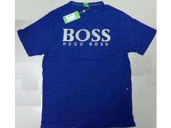 Javascript är inaktiverat. - Dhaka - Helt Ny jättesnygg Hugo Boss blå t shirt, storek XL, modern fit , 100% bomull snabb leverans! butikpris: 599 lycka til! - Dhaka