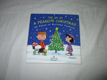 The Joy of A Peanuts Christmas 50 years of holiday comics!