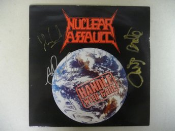 "NUCLEAR ASSAULT - SIGNERAD LP ""HANDLE WITH CARE"" - SIGNED"