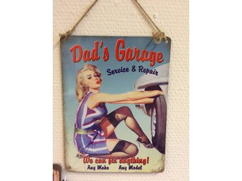 "Retro metallskylt "" Dads Garage""."