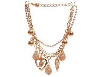 Armband Guldfärgad med berlocker hjärta pärlor (284092620) ᐈ Sustra på  Tradera a89f22a11c22d