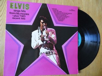 ELVIS sings hits from his movies - plus TWO recent hits