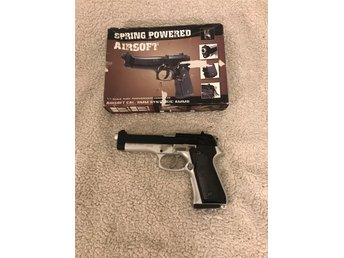 Spring powered Airsoft pistol.