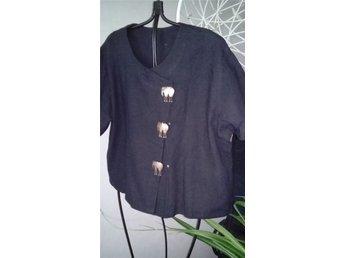 Kortärmad skjorta. kort ärm, svart med elefanter i knäppningen - Luleå - Kortärmad skjorta. kort ärm, svart med elefanter i knäppningen - Luleå