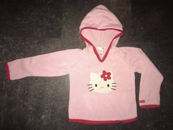 Stickad luvtröja med Hello Kitty, stl 116, fr H&M.