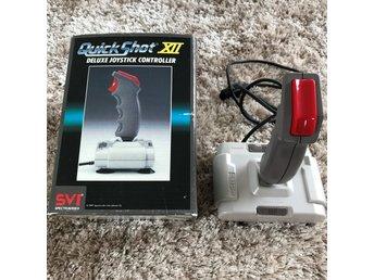 Javascript är inaktiverat. - Hägersten - 1st Quick shot XII joystick till NES-8 bit i fint fungerande skick. 7-pin plug. - Hägersten