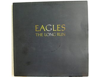"LP. EAGLES - THE LONG RUN. (""FÄRGAD TEXT"")."