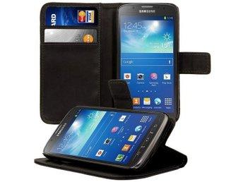 Samsung Galaxy S4 Active Plånboksfodral PU Svart - Gävle - Nu kan du ha telefon och pånbok på ett ställe med dettapraktiska plånboksfodral till Samsung Galaxy S4 Active (i9295)* Skyddar telefonen mot skador och stötar.* Låses enkelt med en magnetflik.* 2 platser för kontokort och legitimation.* Se - Gävle
