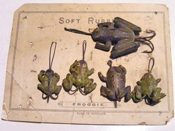 Five gutta percha frog lures.