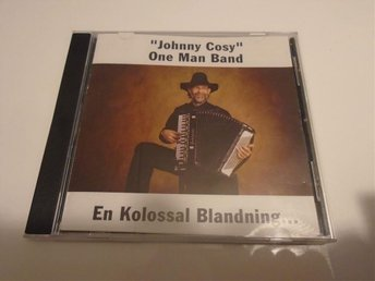 CD MED JOHNNY COSY ONE MAN BAND EN KOLOSSAL BLANDNING...
