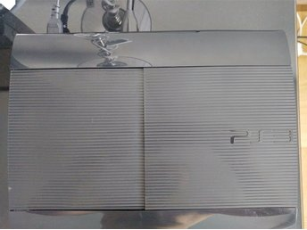 PS3 ultra slim 500Gb + spel
