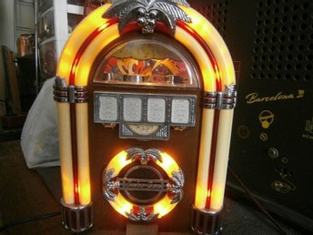 old radio in the shape of a smooth juke box