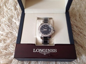 Longines Conquest stålfritt klocka med diamanter.