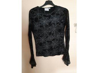 Javascript är inaktiverat. - Hörby - Spindelnät tröja i svart och silverglitter i stl 170 Finns katt i hemmet. Samfraktar. - Hörby