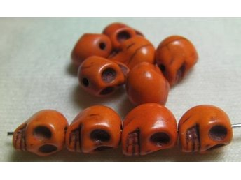 Döskallar Synthetic Howlite 9x7.5mm ** Orange** 20 st