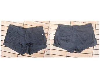 högmidjade shorts gina tricot