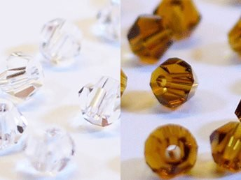 100st Tolstoy 4mm crystal bicone Crystal/Sm. Topaz - Duo Mix
