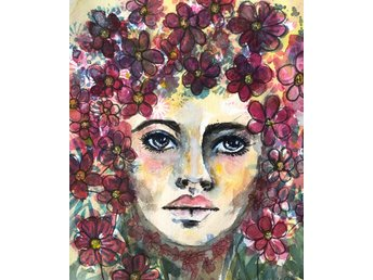 hon har blommor i sitt hår