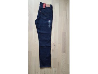 Nya Levis jeans 414 27/32