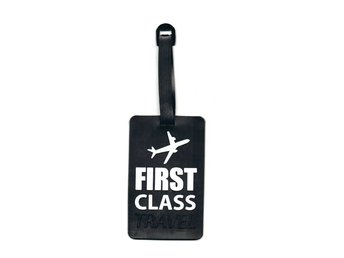 "Bagagetag ""First class travel"", Bagage skylt 10,5x6,5cm"