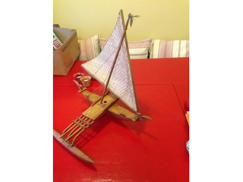 wood model canoe , rafia sail , 30 cms