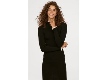 H&M finstickad stickad klänning svart vita detaljer rynk volang LXL ny med tags