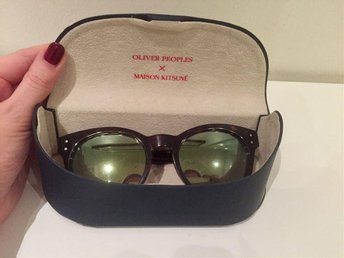 Oliver Peoples x Maison Kitsuné green reflective sunglasses with tortoise frames
