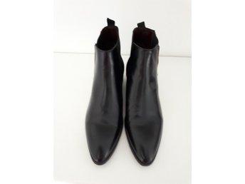 svarta boots dam