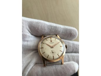 Vintage solid gold manual wind Universal Geneve